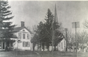 Col. Elias J. Pettibone came to Pine Hill in 1825 and erected this house under the pines that gave the village its picturesque name.
